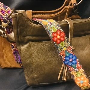 Leather and suede purses by Cristina Orozco.